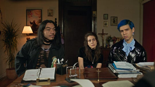 "Renaldo (Bernardo Velasco, left) recruits dental assistant Ursula (Cassandra Ciangherotti) and chocolate company heir Andres (Julio Torres) to help him scare people in HBO's ""Los Espooky."""