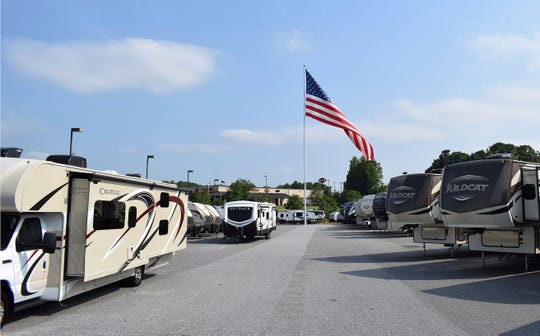 A large American flag blows in the wind at Gander RV in Statesville, N.C.