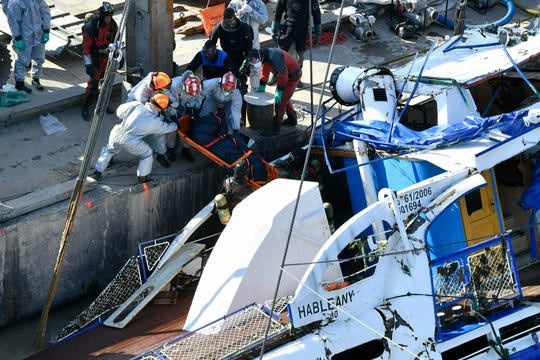 Workers move a recovered body to shore after a crane raised a sunken tour boat that capsized after colliding with a Viking cruise ship on the Danube River in Budapest on May 29.