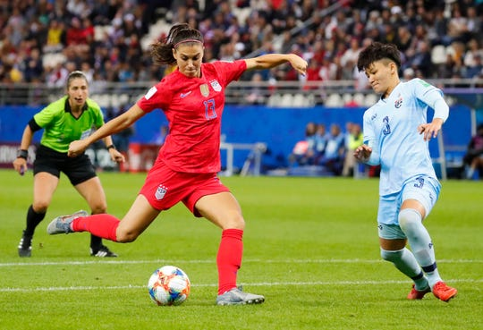 Forward Alex Morgan (13) scores a goal past Thailand defender Natthakarn Chinwong (3) during the second half, one of her five goals in the USA's 13-0 win in their first Group F match on June 11.