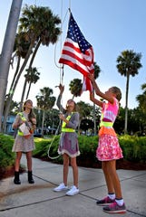 Students raising the American flag in Atlantic Beach, Florida, in 2017.