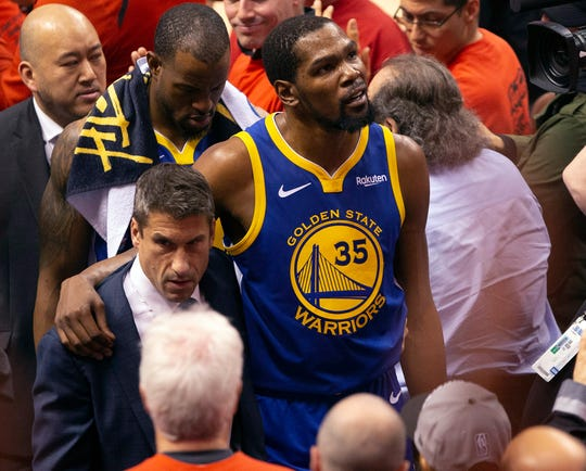 Kevin Durant heads to the locker room after injuring his Achilles.