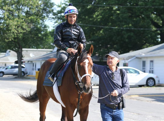 Trainer Jason Servis walks Maximum Security and exercise rider Edelberto Rivas off the track after a morning gallop at Monmouth Park on Wednesday morning June 12, 2019.  Servis will decide by Thursday if Maximum Security will make his next start in Sunday's Pegasus Stakes at Monmouth Park  in Oceanport, NJ.  P