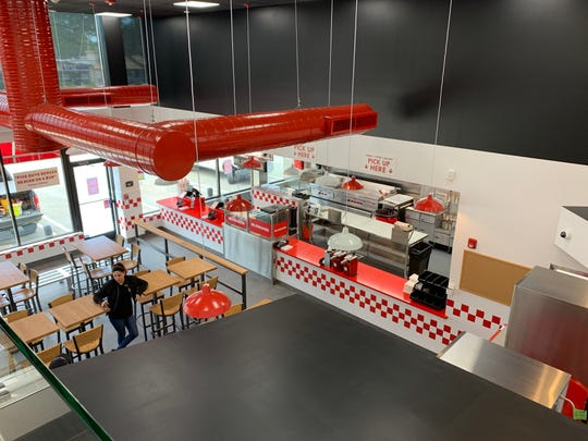 Looking down on the first floor from the mezzanine of the new Five Guys Burgers and Fries in Wall.
