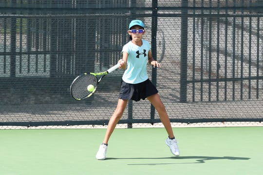 Houston's Laila Nguyen lines up a shot during the semifinals of the Girls 12 singles draw at ACU on Wednesday morning. Nguyen came back to win 4-6, 6-3, 6-0 to reach Thursday's final.