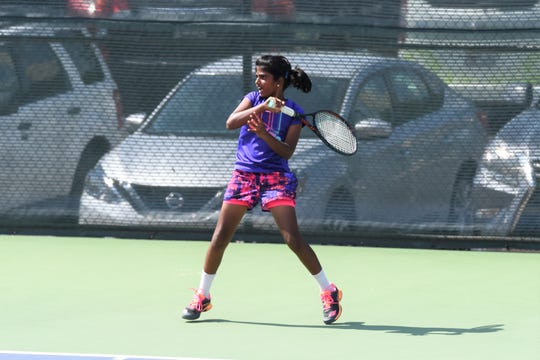 Irving's Meghna Arun follows through on a shot during the semifinals of the Girls 12 singles draw at ACU on Wednesday. Arun won 6-3, 6-0 to reach Thursday morning's final.