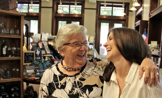 "Jessalyn (Massingill) Beasley is hugged by Hazel Fillmon during Beasley's signing of her work ""Little Birder"" at Texas Star Trading Co. Her granddaughter Allie is married to Beasley's brother Josh."