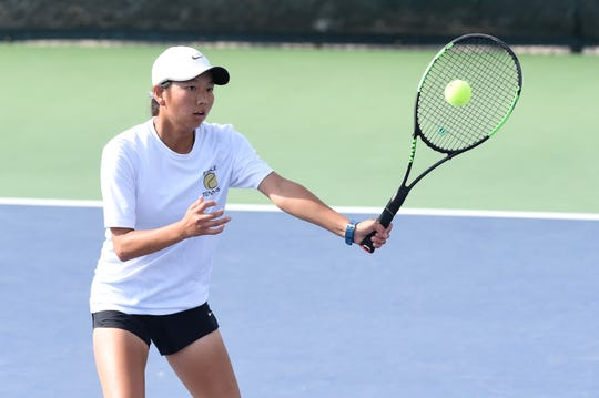 Abilene's Ruth Hill lines up a shot at the net during the fourth round of the Girls 16 singles consolation bracket in the USTA Texas Slam at ACU on Wednesday morning. Hill won 6-2, 6-4 before falling 6-4, 6-4 in the fifth-round qualifier.