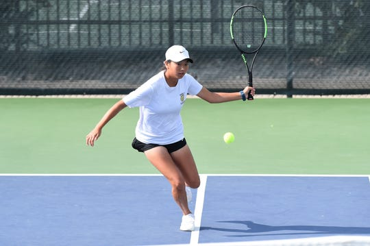 Abilene's Ruth Hill runs up to hit a shot during the fourth round of the Girls 16 singles consolation bracket in the USTA Texas Slam at ACU on Wednesday morning. Hill won 6-2, 6-4 before falling 6-4, 6-4 in the fifth-round qualifier.