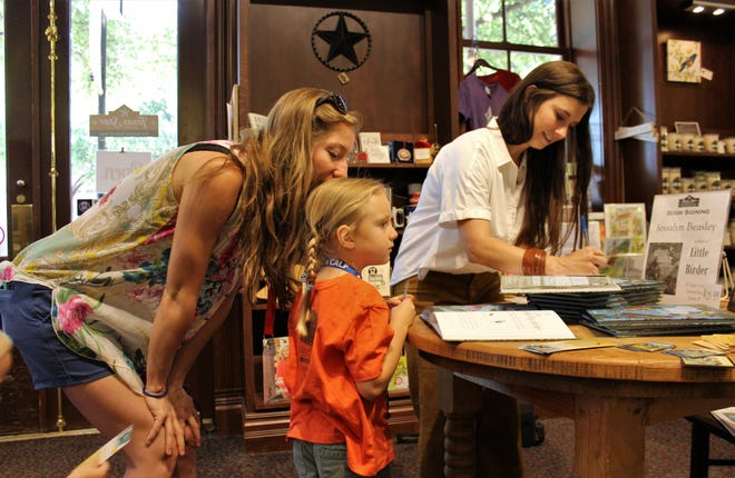 Ashley Hurley brought her children, Emerson (in CALF T-shirt) and Arlo to Jessalyn (Massingill) Beasley's book-signing Saturday at Texas Star Trading Co. The two moms studied abroad for four to five month in Uruguay.