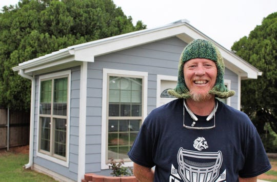 Brian Massey, who launched Houses for Healing in Abilene, wears a knitted hat that seems perfect for his personality. He is standing in front of one of his four tiny homes in north Abilene.
