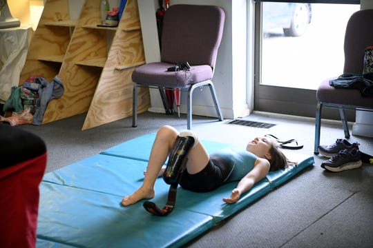 Zoe Smith takes a moment on the mat after vaulting before getting up to try again at Halo Gymnastics, located in a church in Candler, on June 7, 2019. Using a prosthetic leg hasn't slowed the 10-year-old down at all according to her mother who says she is always on the move and looking for something active to do.