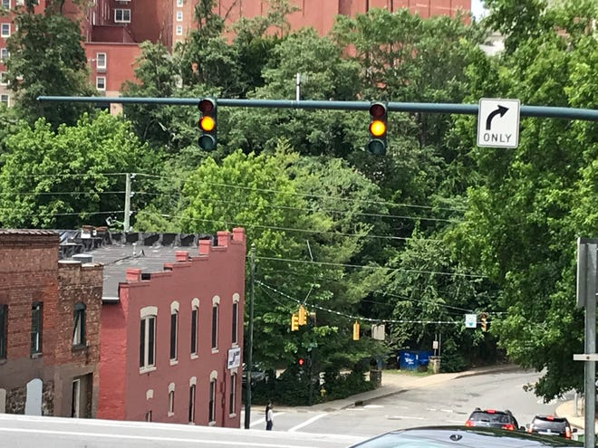 State law requires motorists to stop for a red light, and the yellow light should be taken as an indication to slow down and stop, if possible.