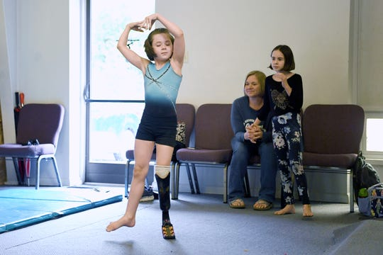 "Zoe Smith, 10, works on her floor routine as her mother, Laila and sister, Fatima, 11, look on at Halo Gymnastics on June 7, 2019. ""She doesn't let anything bother her, she just sort of goes and does whatever she sets her mind to, with anything in her life, and gymnastics has been the same,"" Laila said of her daughter."