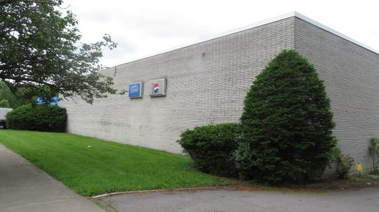 The former Pepsi warehouse on Binghamton's East Side, vacant for five years,  will be developed into an auto service center and a light industrial space.