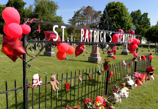 A memorial of balloons and stuffed animals at St. Patrick's Cemetery in Tioga County. Ruby Franciscovich, an 8-month-old baby, was found in a pond behind the cemetery on Sunday and was later pronounced dead. The baby's father, Cody Franciscovich, 25, has been charged with her murder.