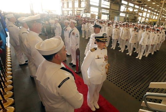 Capt. Dianna Wolfson makes her way to the stage during her change of command ceremony at Puget Sound Naval Shipyard on Wednesday.