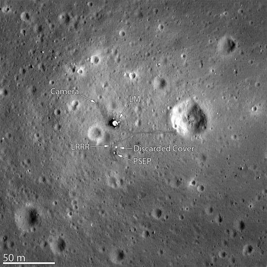 An image captured by NASA's Lunar Reconnaissance Orbiter from 15 miles above the moon's surface shows the Apollo 11 landing site.