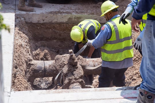 City workers remove a portion of the water line under Chaparral Street on Wednesday, June 12, 2019.