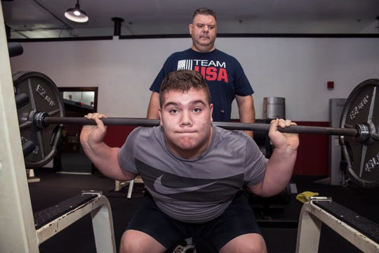 Christian Konoval, 15, works out while his dad, Adrian Konoval, trains and spots him at Pure Energy Fitness on Tuesday, June 11, 2019 in Portland, TX. Christian said that judo has made him a better person and in general the sport teaches time management.