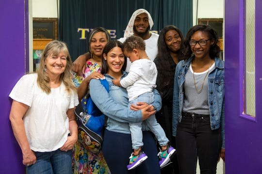 Newspaper advisor April Saul, from left, family operations coordinator Mia Anderson-Coles, Ana Lopez, 19, with her son Aiden Rosa, 2, Ron Custis III, 18, Jasmine Barge, 18, and Nashia Montgomery, 18, inside Camden High School at Hatch in Camden, N.J. on Tuesday, June 11, 2019.