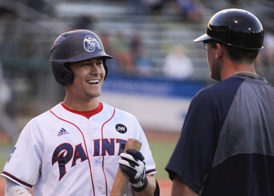 Chillicothe Paints and Penn State infielder Gavin Homer laughs with assistant coach Chad Roberts in a 17-0 win over Champion City on June 11.