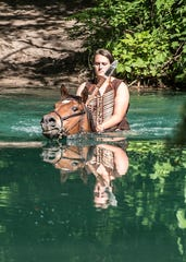Assistant equestrian Taylor Wheaton works with her horse as the animal goes through the water pond for one of the scenes for the annual Tecumseh outdoor drama at Sugarloaf Mountain this summer.