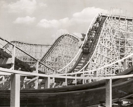APRIL 22, 1956: The Wildcat and Shooting Star will be in operation when Coney Island holds its first weekend preview Saturday and Sunday. Wildcat and Shooting Star dips intermingle in this photo at Coney Island. Coney Island, Cincinnati