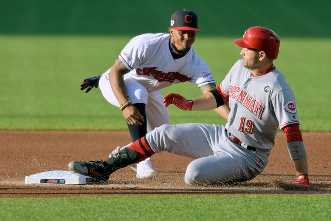 Jun 11, 2019; Cleveland, OH, USA; Cincinnati Reds first baseman Joey Votto (19) slides in to second base with a double against Cleveland Indians shortstop Francisco Lindor (12) in the first inning at Progressive Field. Mandatory Credit: David Richard-USA TODAY Sports