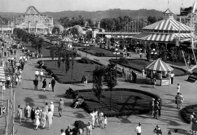 MAY 1928: Guests are dressed up for a visit to Coney Island's mall, to ride roller coasters or the Ferris wheel, or just go for a stroll.