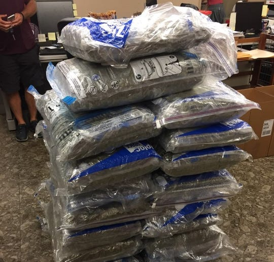Bags of marijuana seized by Cincinnati police on Sept. 18, 2018 in Fairview from two SUVs driven by California men.