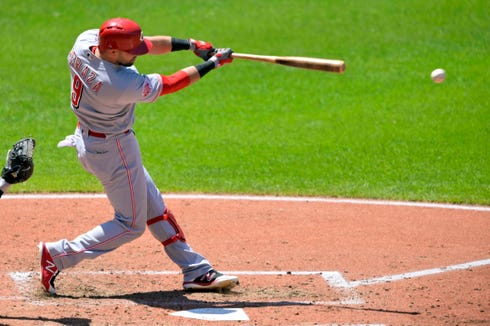 Cincinnati Reds second baseman Jose Peraza (9) hits an RBI double in the fifth inning against the Cleveland Indians at Progressive Field.