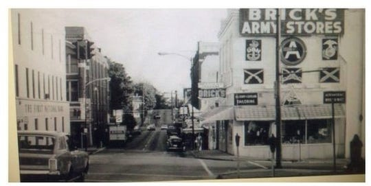 A photo of the Dabbs building in downtown Clarksville when it was used at the Brick's Army Store, likely from the late 1960's.