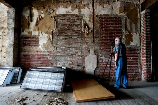 Gary Norris, the chairman of the historic zoning board, takes pictures of the interior during a walk through visit at the Dabbs Building in Clarksville, Tenn., on Wednesday, June 12, 2019.