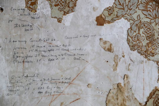 Writing from the 1800s that was covered by wallpaper can be seen on a wall during a walk through visit at the Dabbs Building in Clarksville, Tenn., on Wednesday, June 12, 2019.