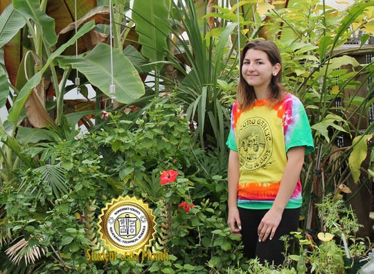 Abigail Podejko, the June 2019 Student of the Month at Somerset County Vocational & Technical High School poses for a photo surrounded by plants in a greenhouse at SCVTHS.