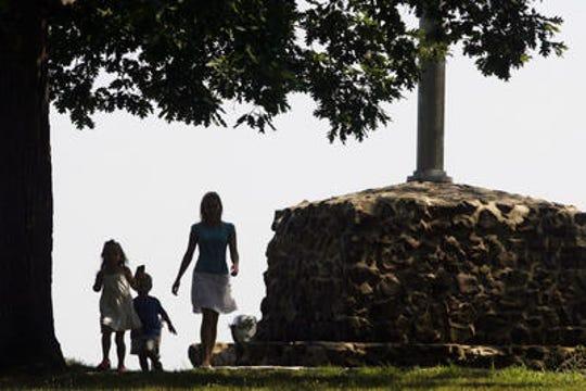 Allison Lyons of Somerset and her two children, Patrick and Peyton walk through Washington Rock Park