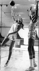 Denise Long takes a shot against a San Francisco Warriors player in this undated photo. Long was drafted by the Warriors out of Union-Whitten High School after one of the most storied careers in Iowa girls' basketball.