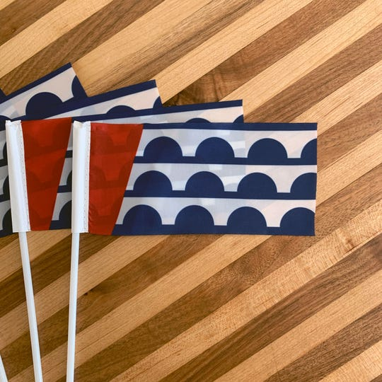 Smaller versions of the Des Moines flag available for sale through the Flag of Des Moines online store on June 12, 2019.