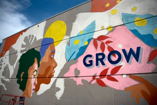 "Amanda Phingbodhipakkiya's in-progress mural, ""A Place to Grow,"" is seen on Drake University's campus in Des Moines."