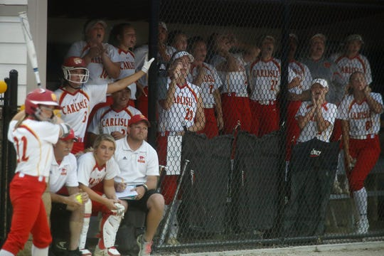 The Carlisle bench cheers from the dugout. Class 4A No. 3 Carlisle beat No. 4 Dallas Center-Grimes 10-3 in a June 11 home game.