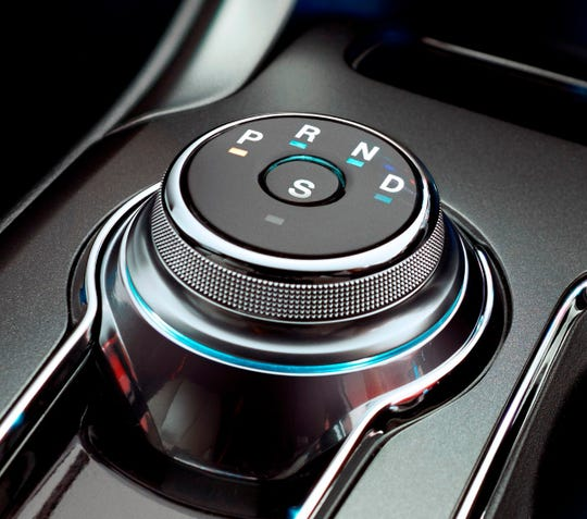 "2017 Ford Fusion Sport Rotary Gear Shift Dial - ""Return to Park"" can help drivers have extra peace of mind that their 2017 Fusion will select Park – as intended – even if they forget to turn the dial to ""P"" or accidently leave the car in another gear when parking."