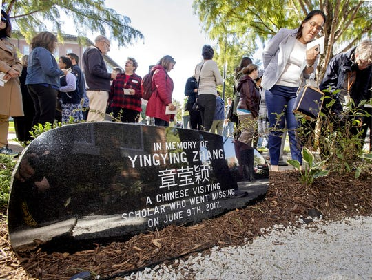 This Oct. 11, 2018, file photo shows guests mingling after a ceremony to dedicate the memorial garden for Yingying Zhang, Chinese scholar who disappeared from campus in June 2017.