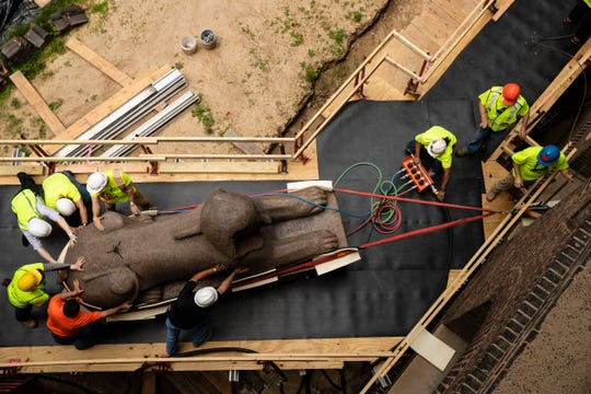 Workers move a 25,000-pound Sphinx of Ramses II at the Penn Museum in Philadelphia, Wednesday, June 12, 2019.