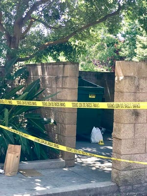 This photo released Tuesday, June 11, 2019, by the Stockton Police Department shows the scene where an abandoned baby was found in Stockton, Calif. An apartment building resident heard cries and notified the manager, who pulled the child from the building's dumpster.