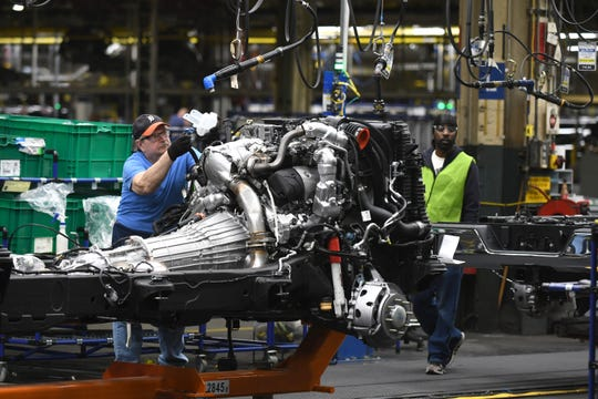 Workers assemble the chassis for GM trucks at the Flint Assembly where GM President Mark Reuss announced that General Motors will invest $150 million.