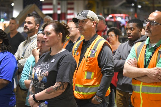 Workers listen as GM President Mark Reuss makes an announcement Wednesday in Flint that General Motors will invest $150 million at its Flint Assembly to boost production of the Chevy Silverado and Sierra heavy-duty pickup trucks.