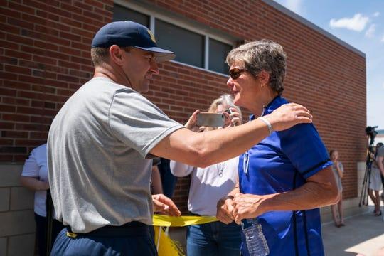 Michigan softball coach Carol Hutchins right, chats with Michigan baseball  coach Erik Bakich.