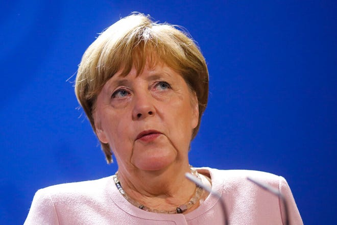 German Chancellor Angela Merkel attends a joint statement with Abu Dhabi's Crown Prince Mohamed Bin Zayed prior to meeting at the chancellery in Berlin, Germany, Wednesday, June 12, 2019. Donald Trump upped his criticism of Germany on Wednesday as he threatened sanctions over Merkel's continued support for a gas pipeline from Russia.