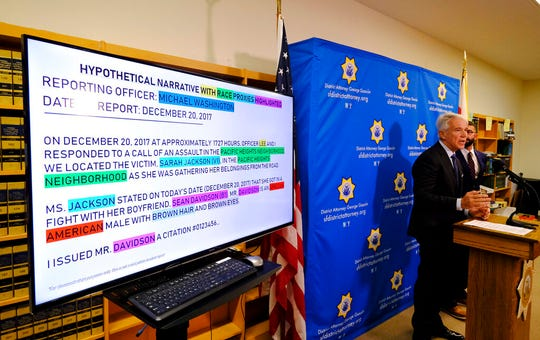 With a hypothetical police report displayed, San Francisco District Attorney George Gascon talks about the implementation of an artificial intelligence tool to remove potential for bias in charging decisions during a news conference Wednesday, June 12, 2019, in San Francisco.